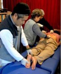Acupressure instructor Hue Loc applying Dien Chan technique
