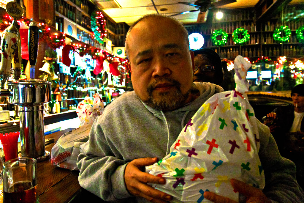 Linh Dinh in Jack's Bar with Christmas care package