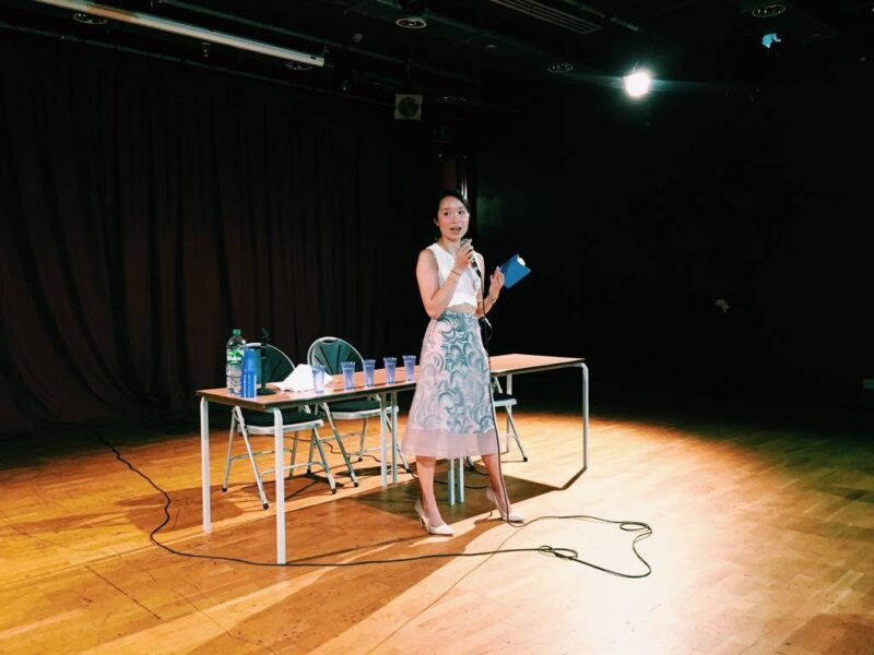 Julia Thanh introducing an event